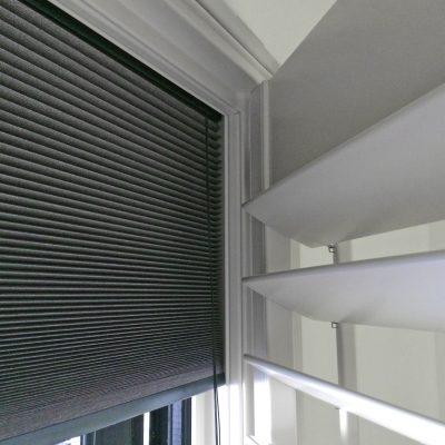 Shutters With Integrated Room Darkening Blind